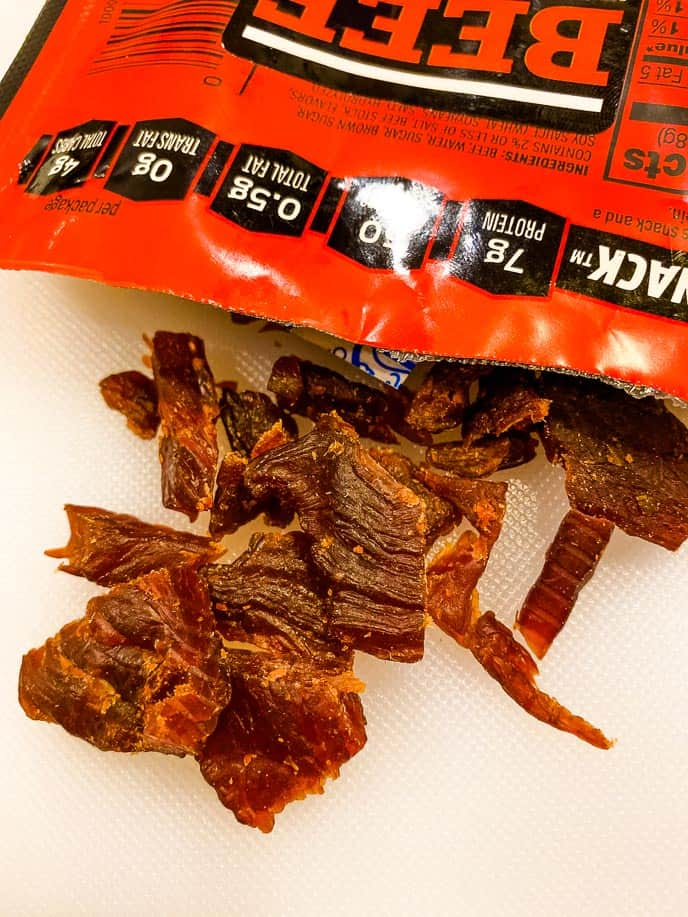 Beef jerky on white board