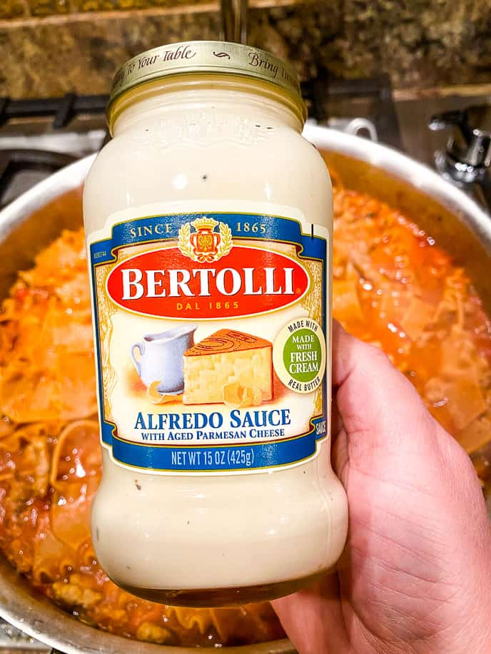 Jar of Bertolli alfredo sauce for this easy meat lasagna recipe