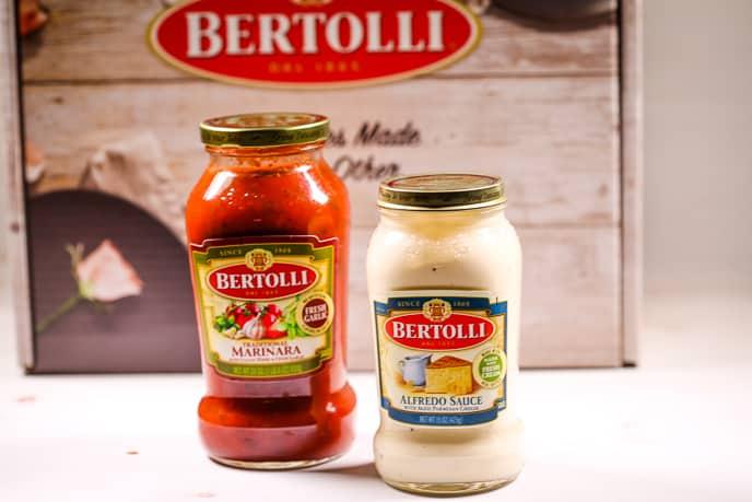 Jars of Bertolli marinara and alfredo sauces
