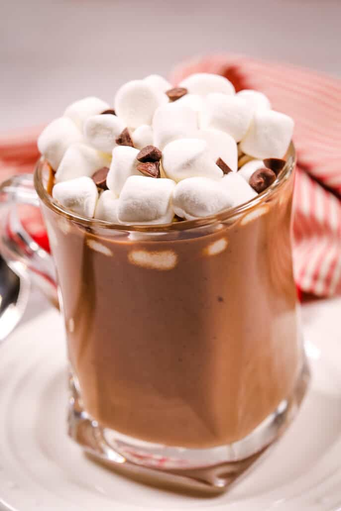 slow cooker hot chocolate with marshmallows and a striped napkin