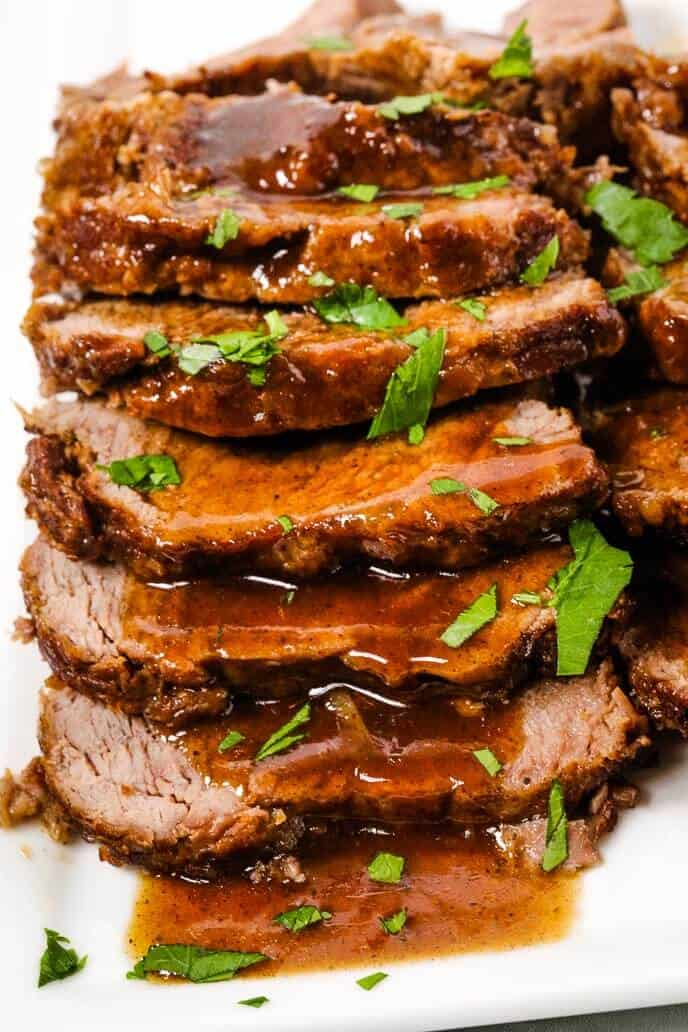 Instant pot beef with balsamic sauce on a white plate