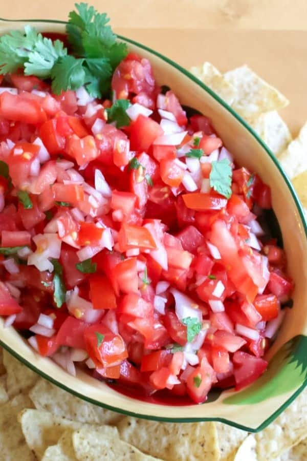 homemade pico de gallo in a bowl with tortilla chips