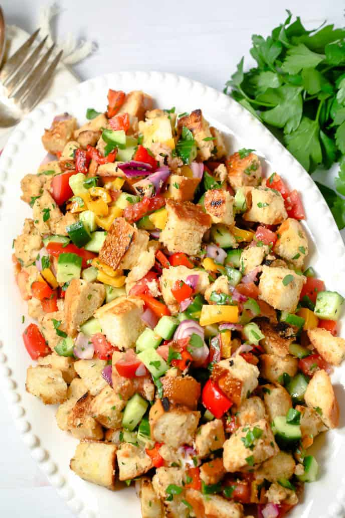 Grilled Panzanella recipe on a white plate with fork and parsley