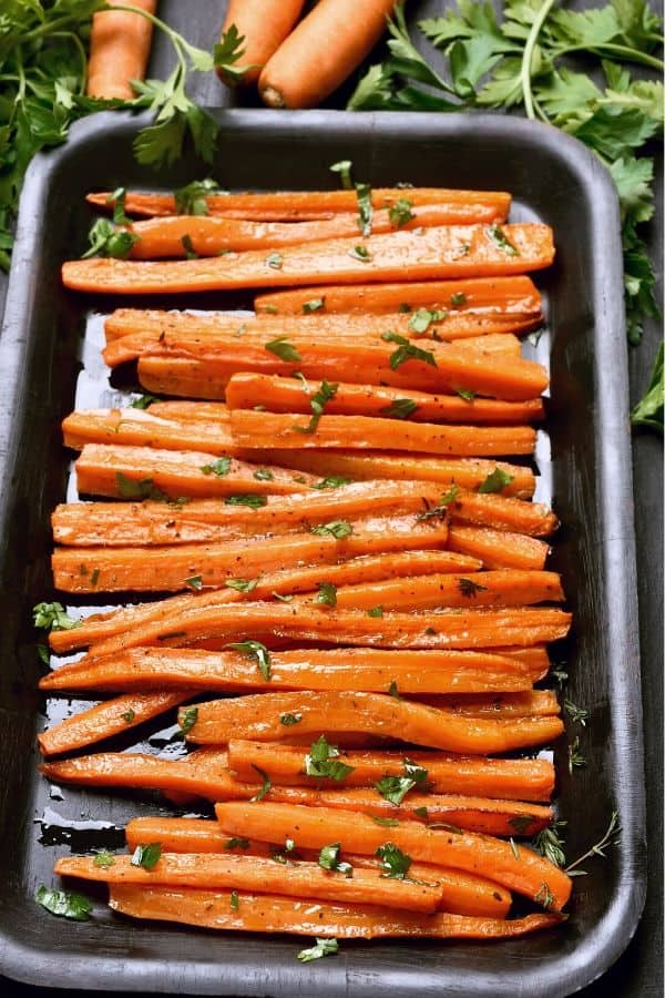 Picture of Roasted Baby Carrots in a black roasting pan