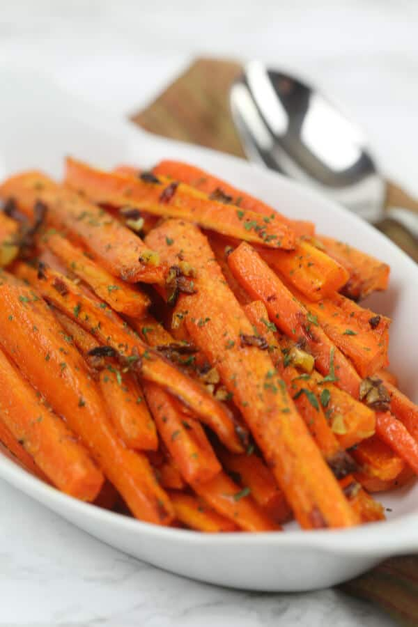 Garlic Roasted Carrots in a white dish