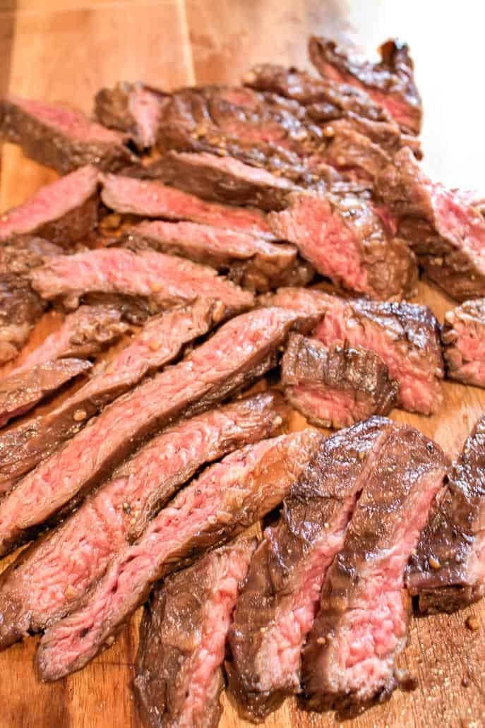Sliced Grilled Skirt Steak on a wooden board