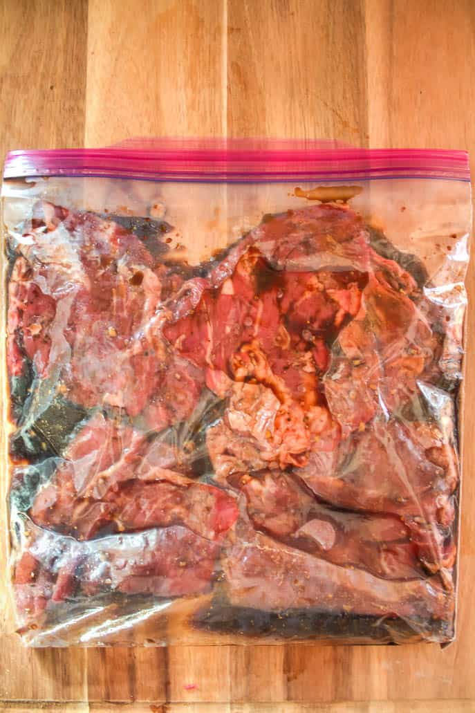 Steak in a zip lock bag with marinade for grilled skirt steak