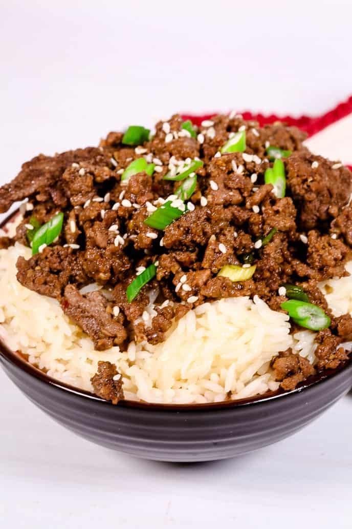 Close up of Beef Bulgogi bowl with rice in a black bowl