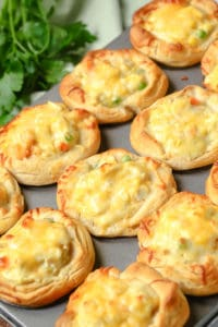 row of chicken pot pie puffs on a sheet
