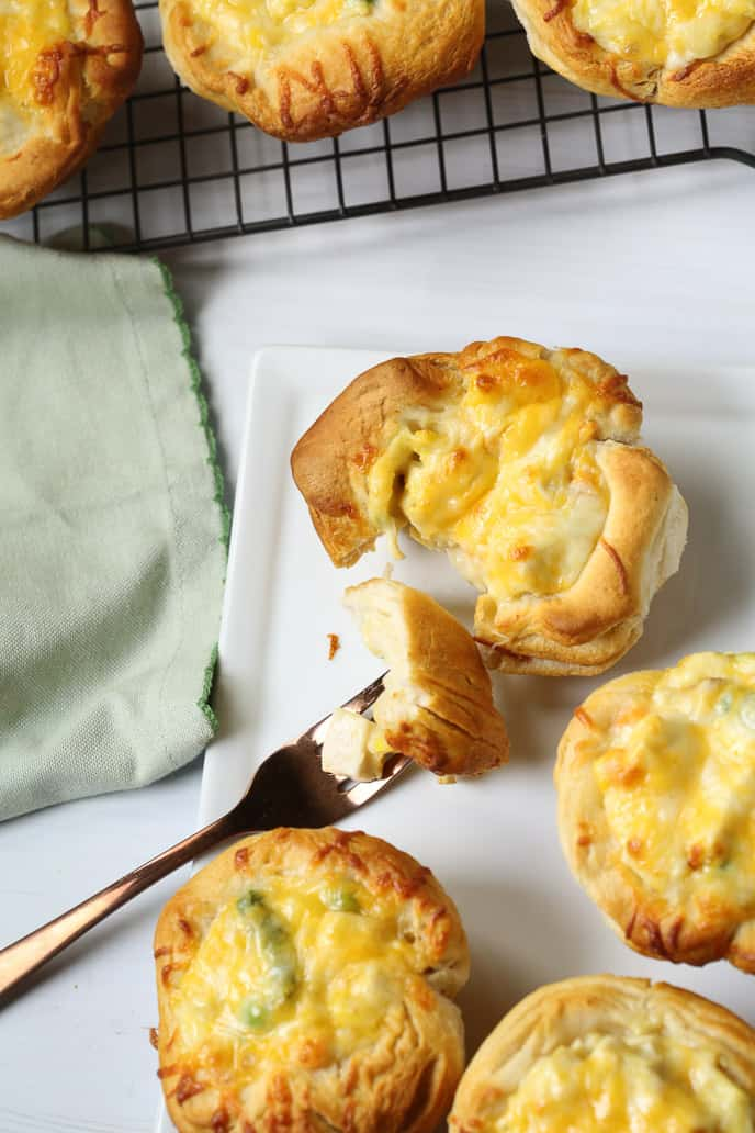 Easy Chicken pot pie with biscuits on a fork with a  green napkin