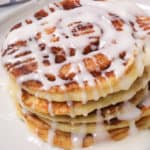 Cinnamon swirl pancakes on a white plate