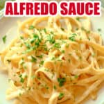 White plate filled with Alfredo and parsley on top