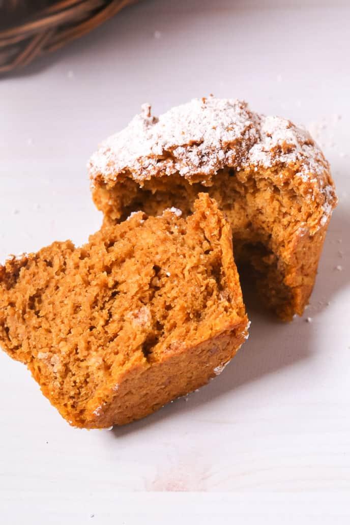 A single pumpkin muffin split in half.