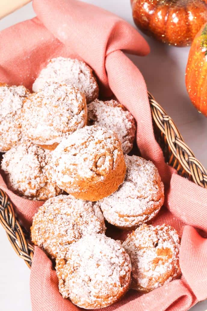 Easy pumpkin muffins topped with powdered sugar in a basket.