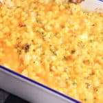 Cheesy Bacon and Corn casserole in a white baking dish