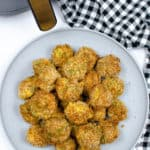 Top view of Mac and cheese bites with black and white table cloth
