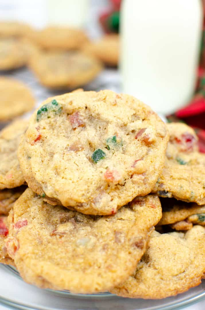 fruitcake cookies on a plate with a glass of milk in the background