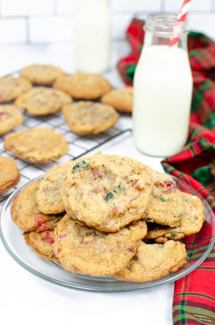 Best fruit cake cookies on a plate with extra cooling in the background next to a glass of milk