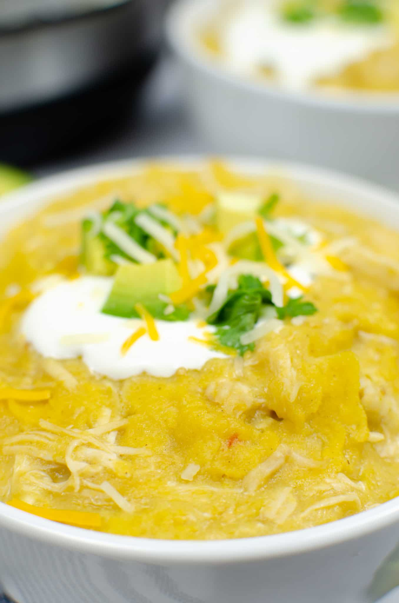 Close up of top of a bowl of Instant Pot Green Enchilada Chicken Casserole
