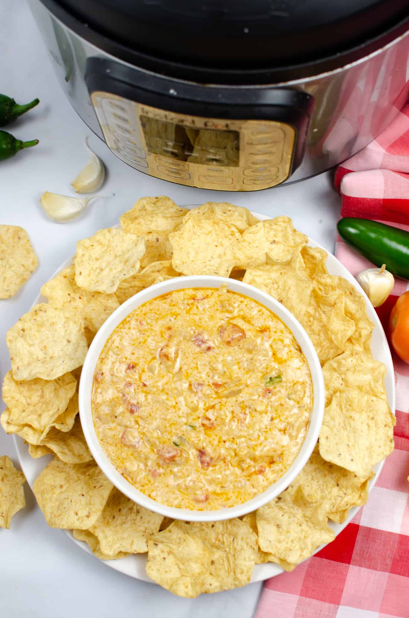 Photo looking down at Instant pot queso with meat and chips