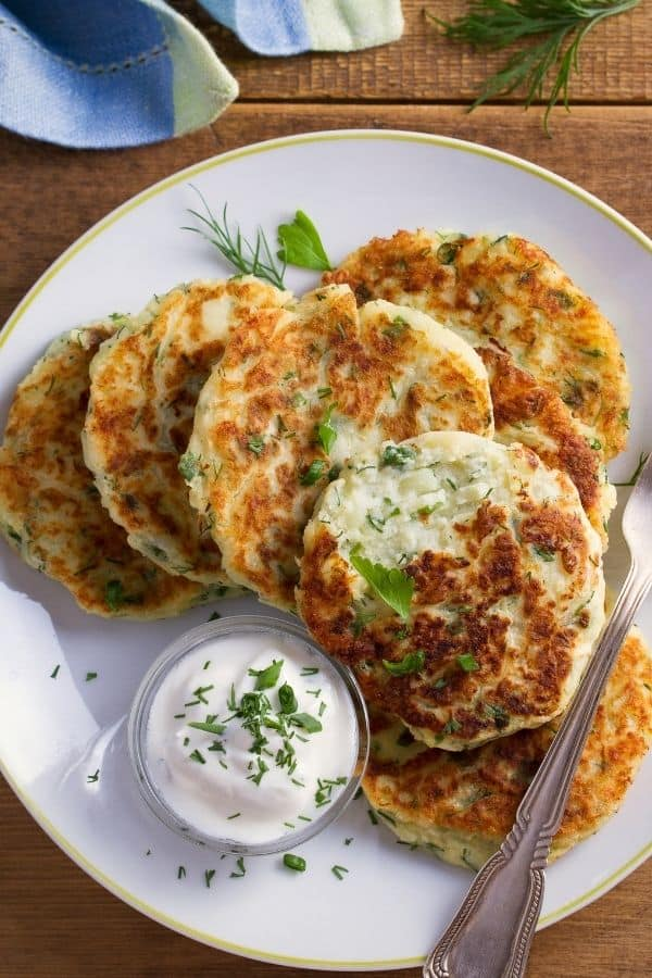 close up of mashed potato pancakes with sour cream