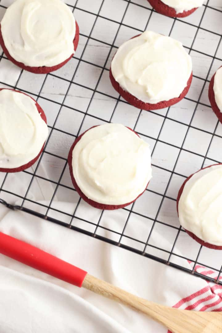 Red velvet cookies recipe with buttercream frosting on a wire cooling rack