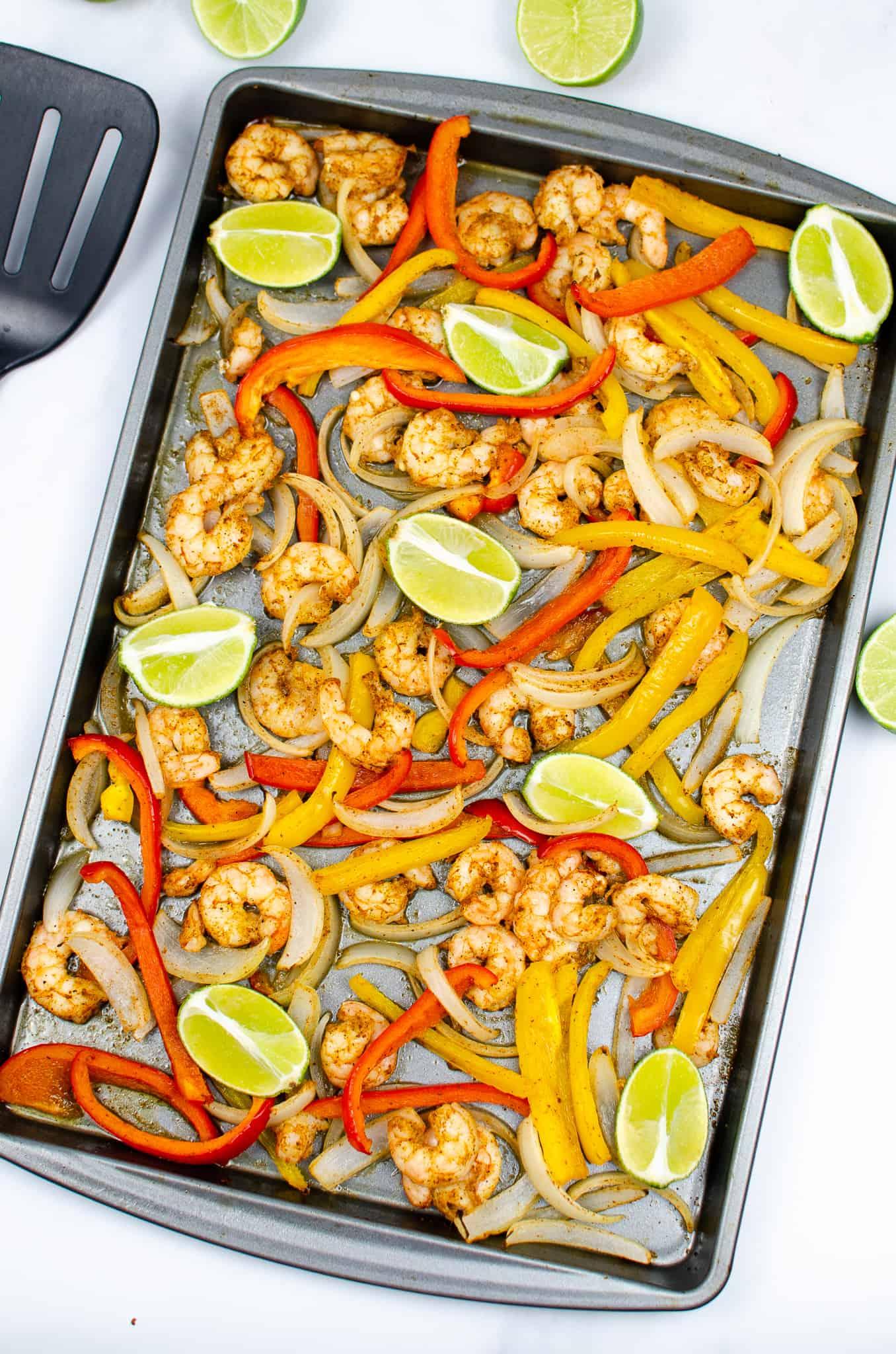 Sheet pan on oven of Sheet Pan Shrimp Fajitas