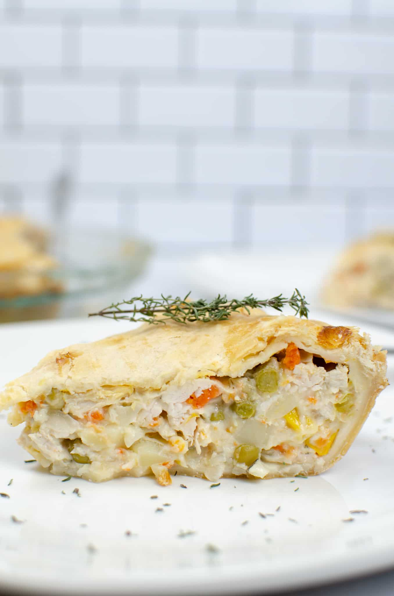 Close up on pie with a sprig of thyme