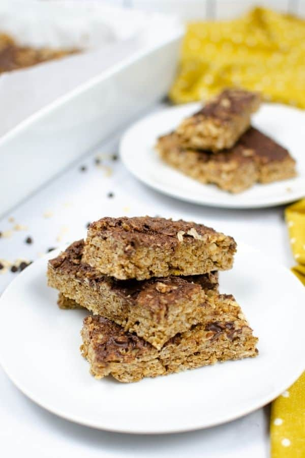 2 white plates with chocolate chips granola bars.