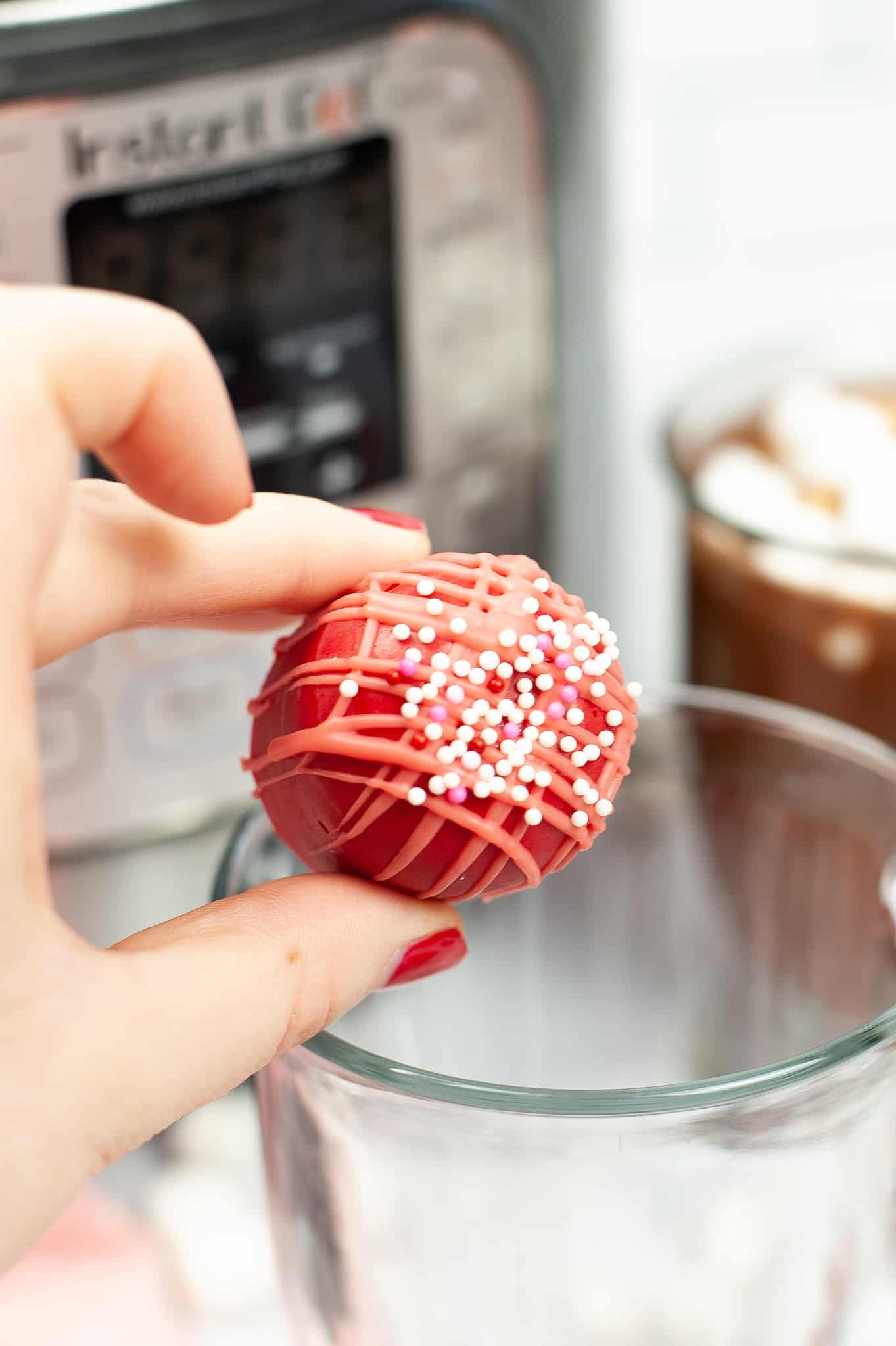 Close up of Hot Chocolate ball being dropped into milk