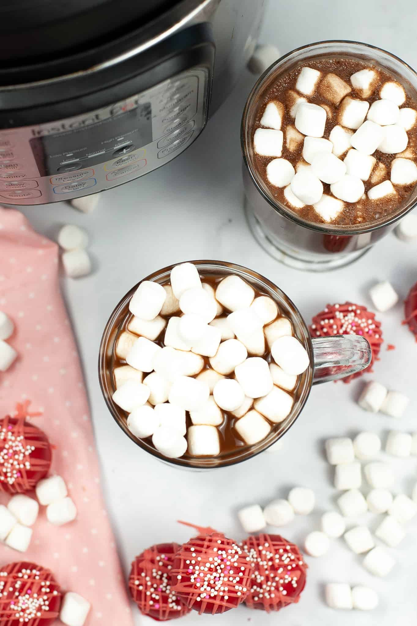 Close up on Hot Chocolate made with a hot chocolate bomb with more on the sides