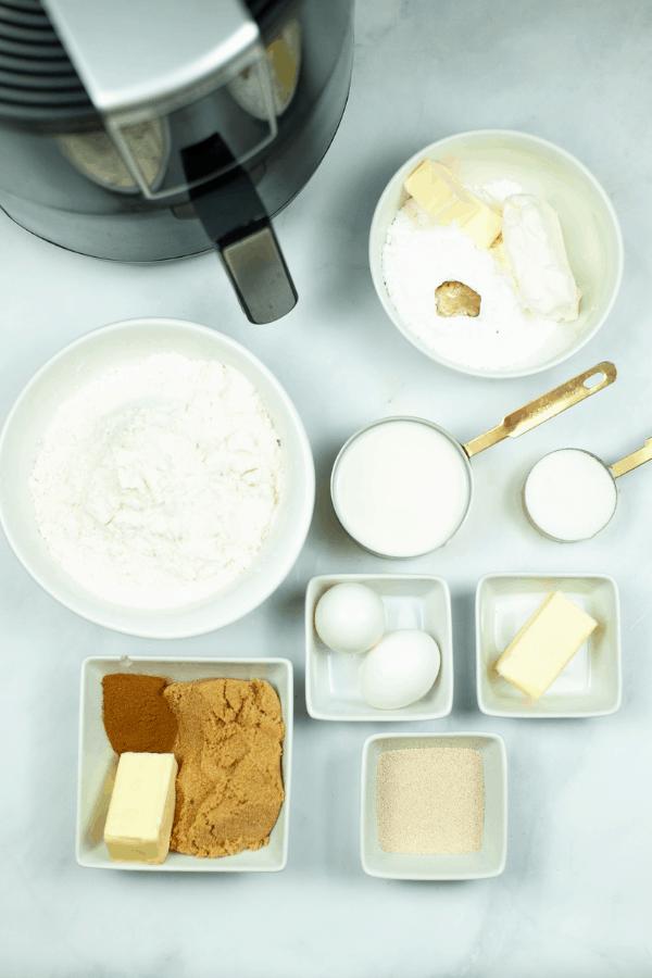 Air Fryer, Eggs, Butter sugar flour and all the necessary ingredients to make Air Fryer Cinnabon Rolls