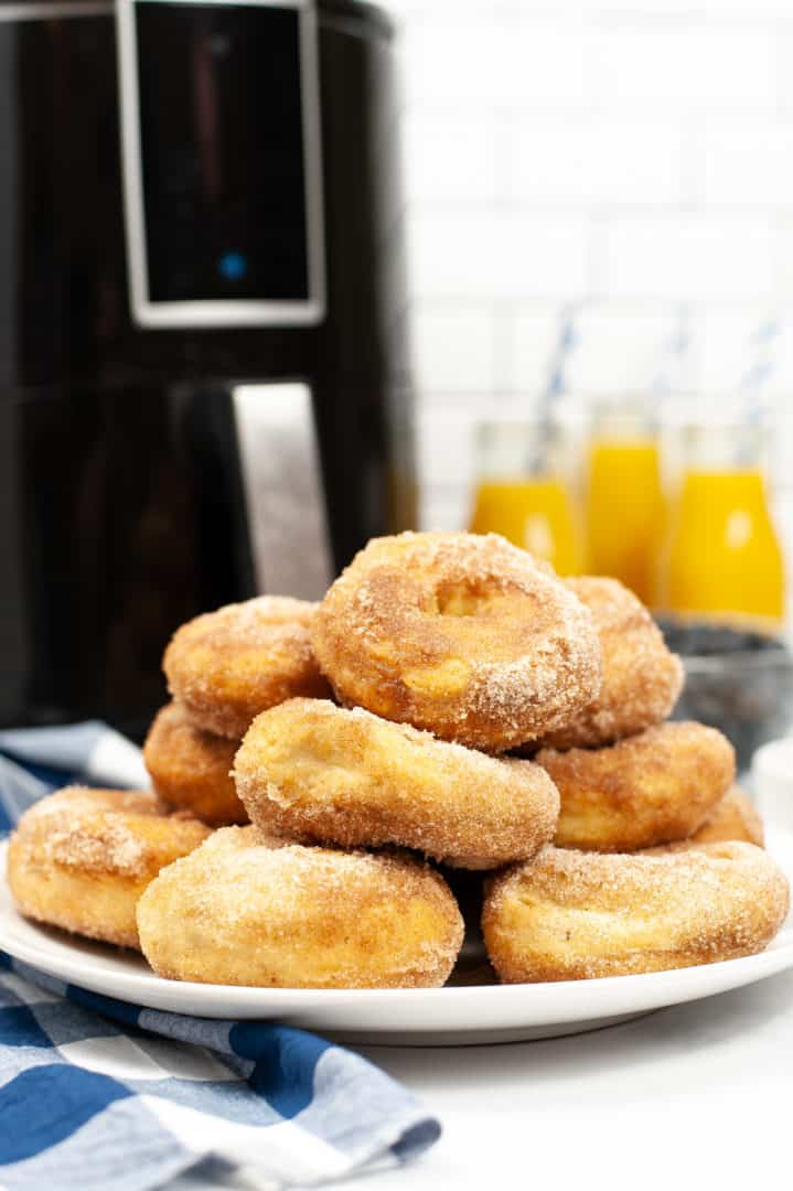 A plate of air fryer cinnamon donuts