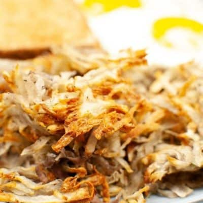 Close on a breakfast plate with air fryer hash browns and eggs