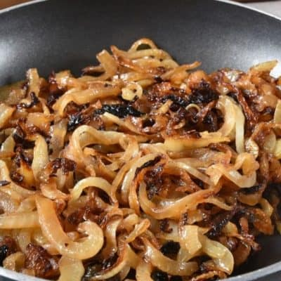 Pan filled with golden fried onions.