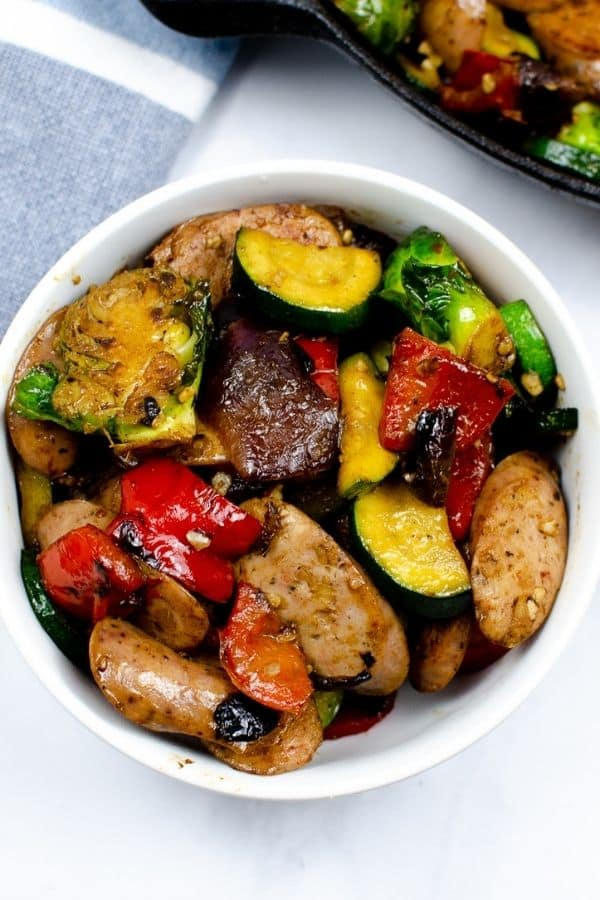 top shot of white bowl of chicken apple sausage vegetables