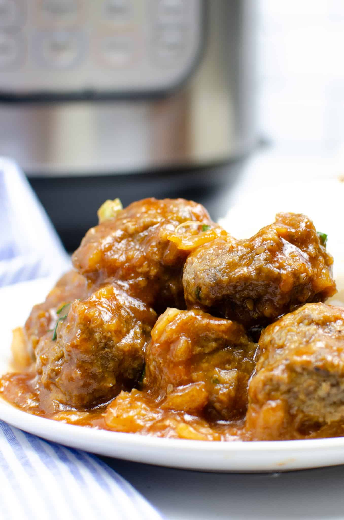 Plate of Instant Pot Hawaiian Meatballs with an Instant Pot in the background