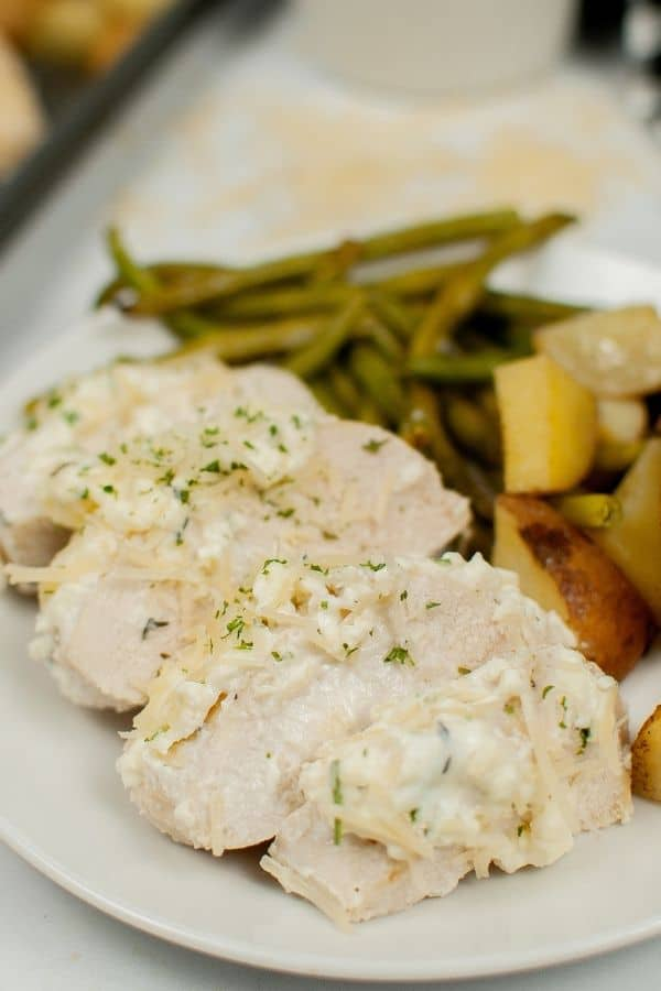 White Plate with the Creamy Garlic Chicken and Vegetables on it.
