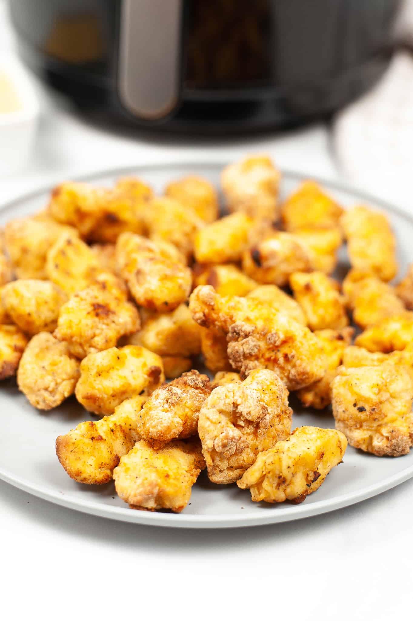 White Plate of crunch air fryer chicken nuggets