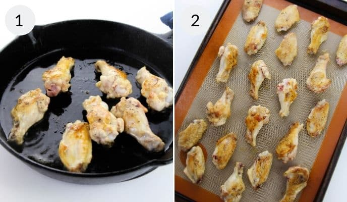 Wings cooked in a pan and then on a silpat lined baking sheet