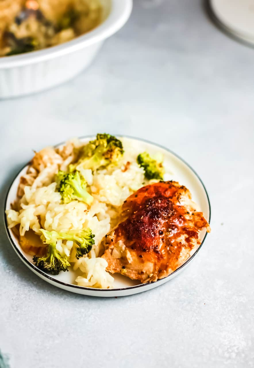 White plate with a serving of the chicken broccoli and rice casserole on the plate