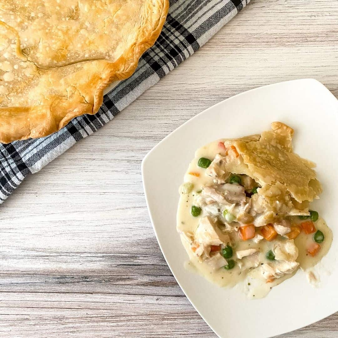 close up on plate of chicken pot pie with crust