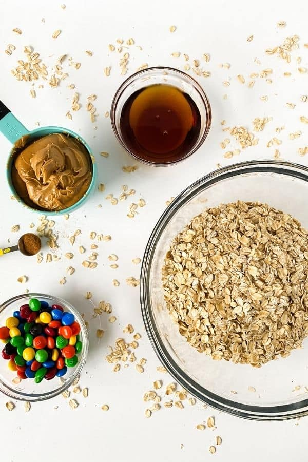 bowl of oats, coated candies, peanut butter and vanilla