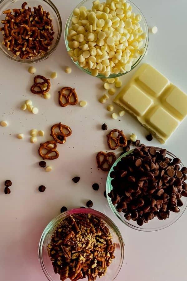 Bowls of chocolate and pretzels needed for the crock pot pretzel treats
