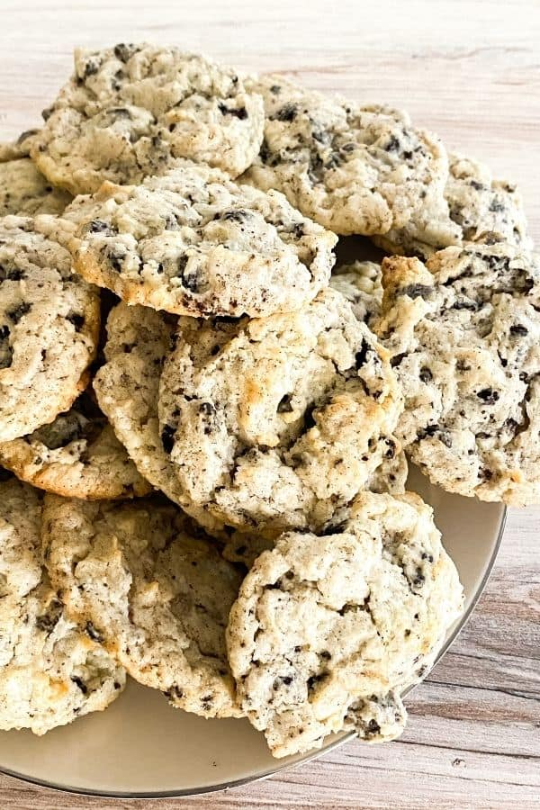 A heaping batch of oreo cheesecake cookies in a white plate
