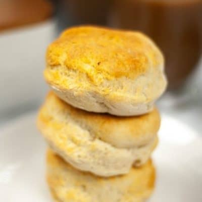 A stack of air fryer biscuits on a white plate.