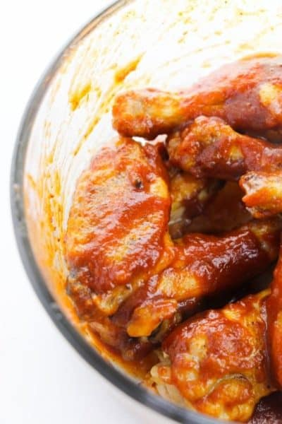 Glass bowl filled with honey bbq wings