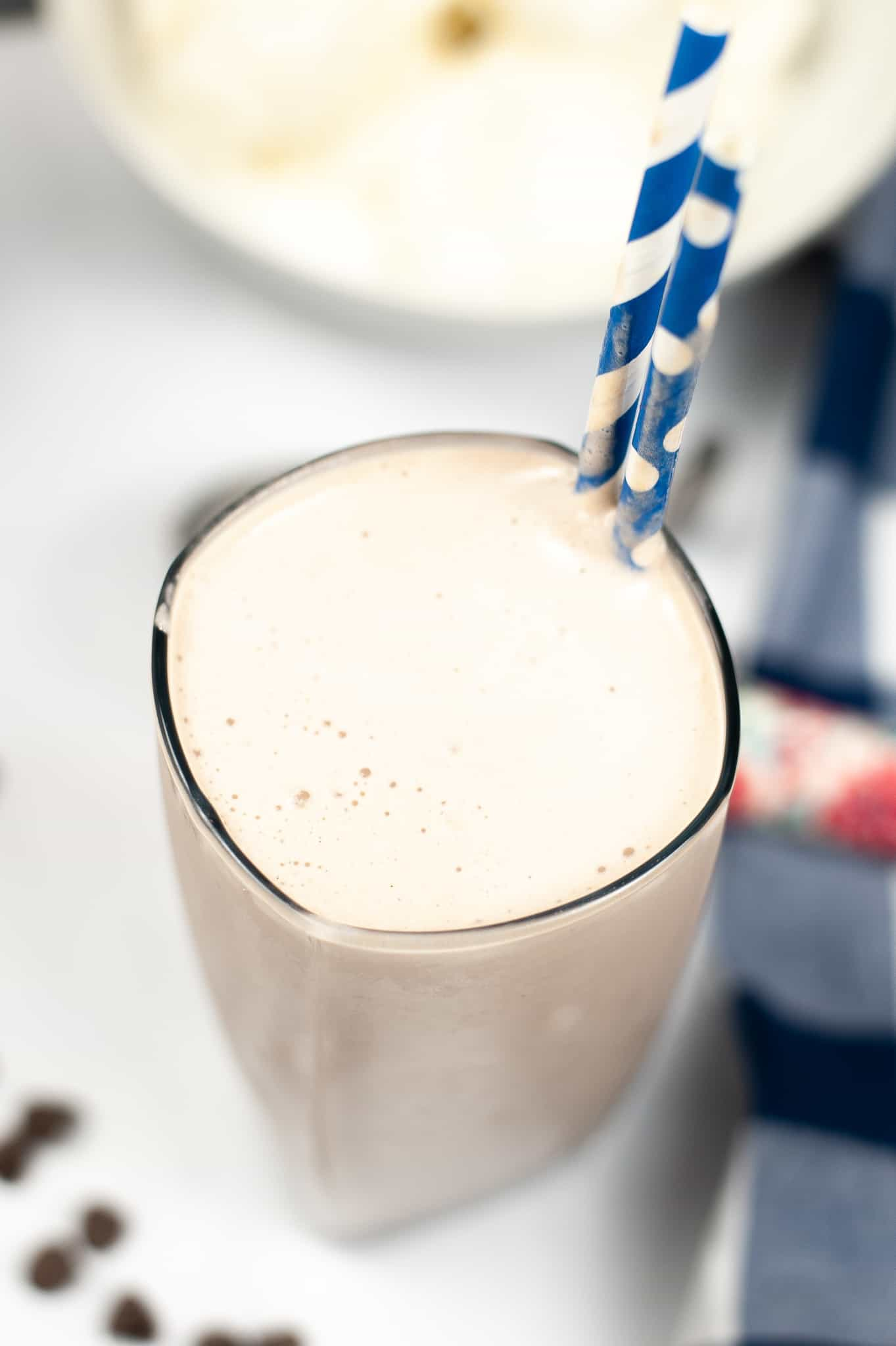 Top shot of a wendys frosty with two blue and white straws.