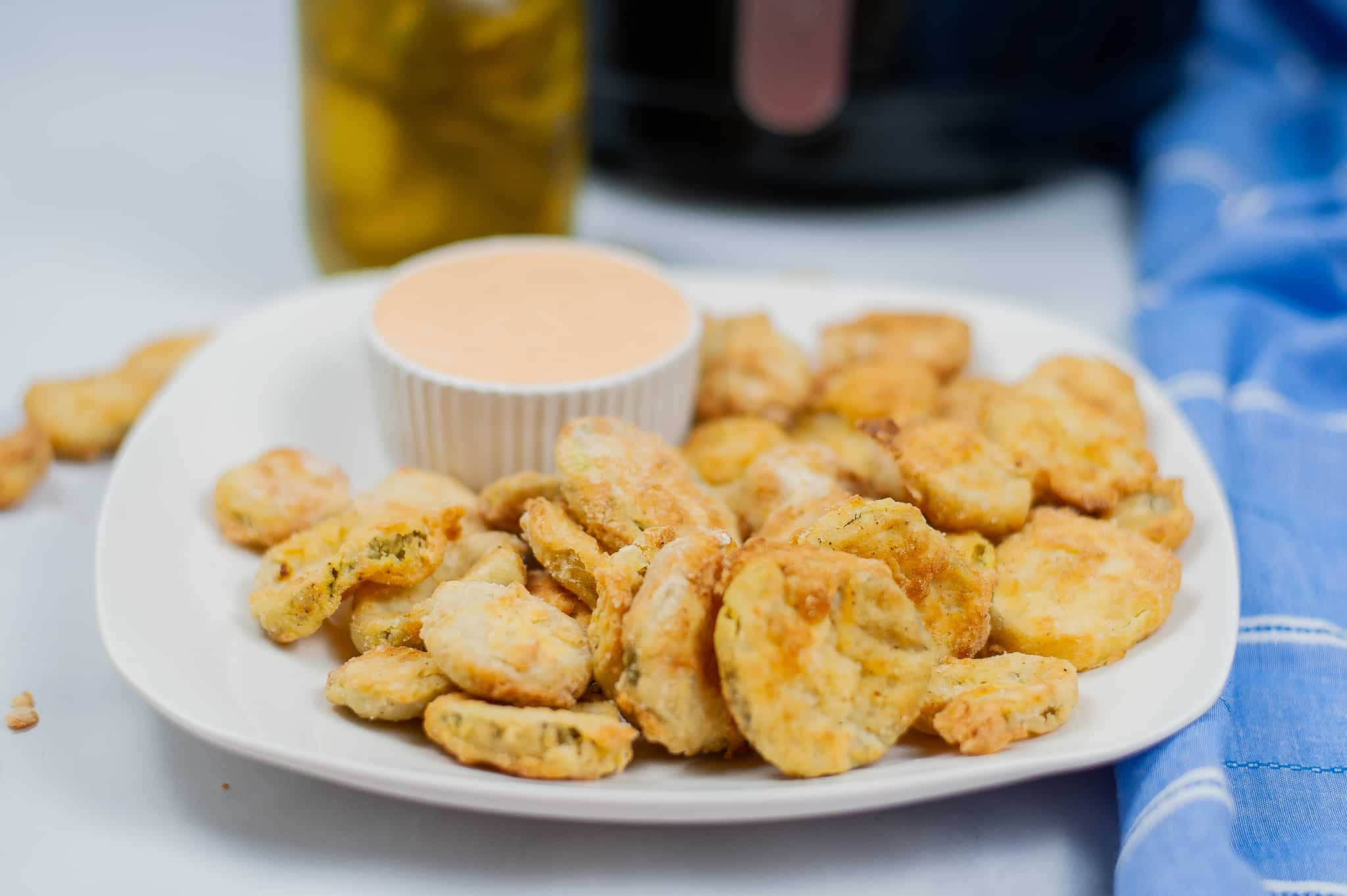 Side view of air fried pickles.