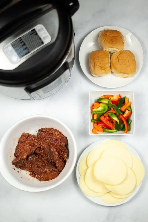 Instant pot, steak, vegetables, rolls and cheese.